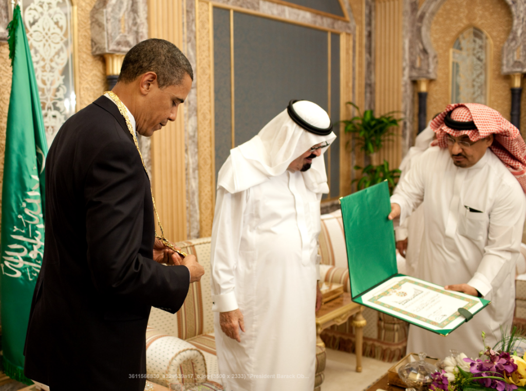 Obama receiving Saudi Arabia's Order of Merit from the late Saudi King Abdullah Aziz at the start of their bilateral meeting in Riyadh, June 2009. Official White House photo by Pete Souza